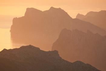 First lights at dawn over the coast of Pollensa. Tramuntana mountains, Majorca