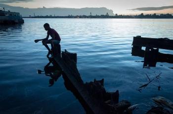 silhouette in Havana Bay by Louis Alarcon
