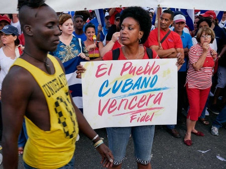 cuban people in may first day photography by louis alarcon
