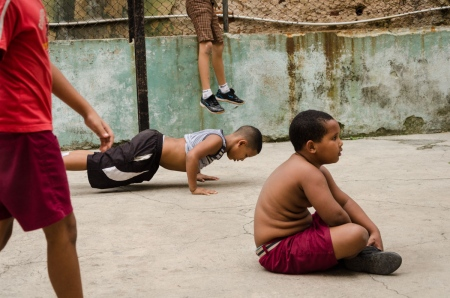 children in a boxing gym in cuba , photography tour by louis alarcon