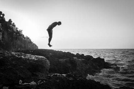 extrange jumper in malecon of Havana in a workshop of photography in Cuba